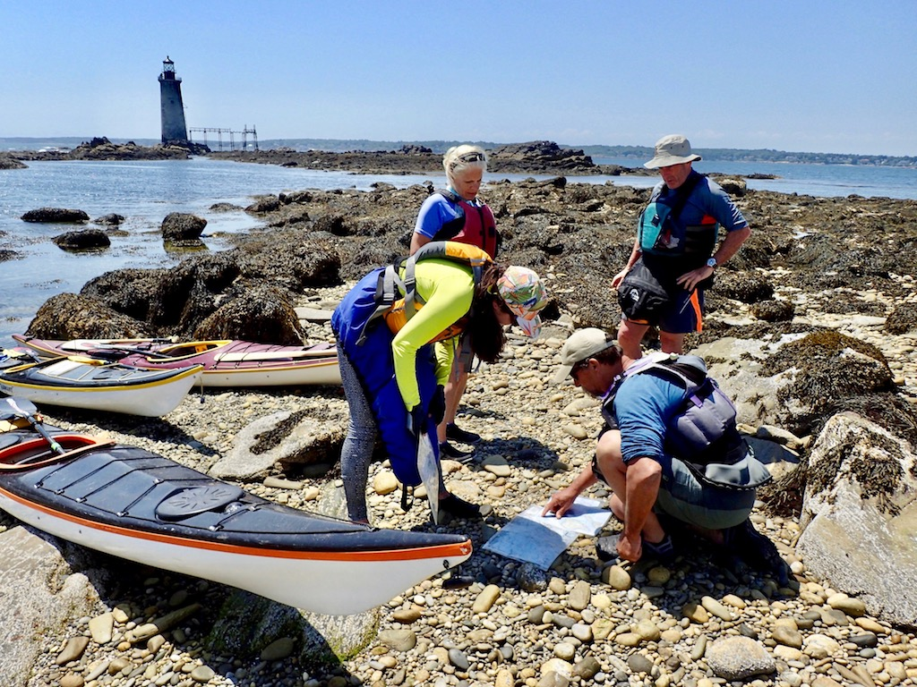 sea kayak navigation instruction on an island in Casco Bay