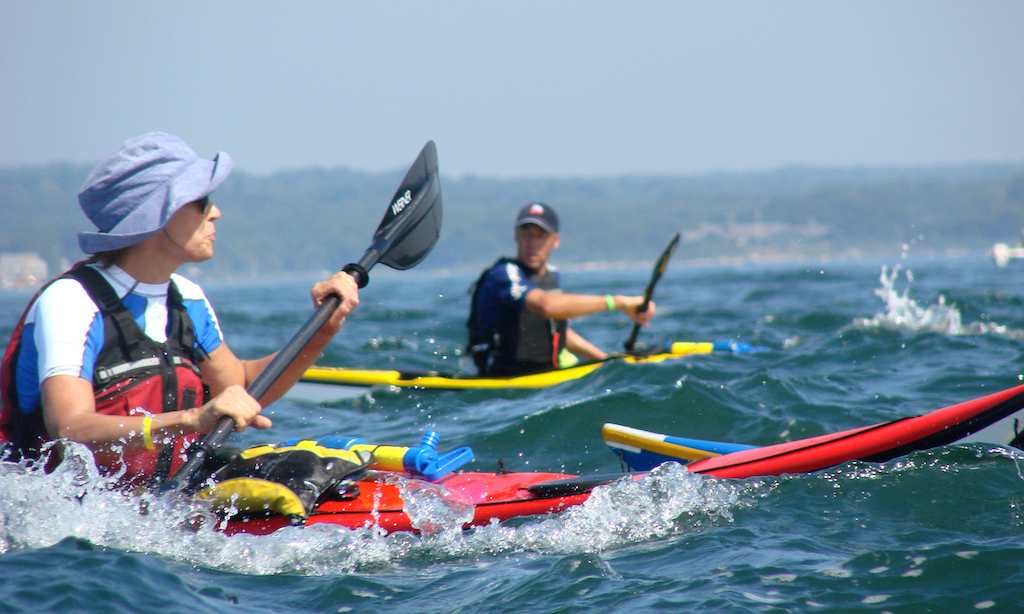 sea kayakers in small waves