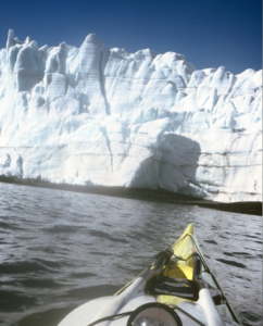 paddling toward an Antarctic glacier