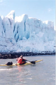 Nigel kayaking by Antarctic glaciers