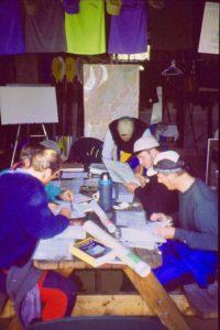 Sea kayakers studying navigation