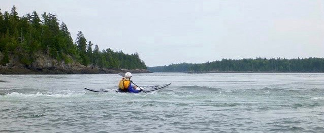 kayaker near an eddy line