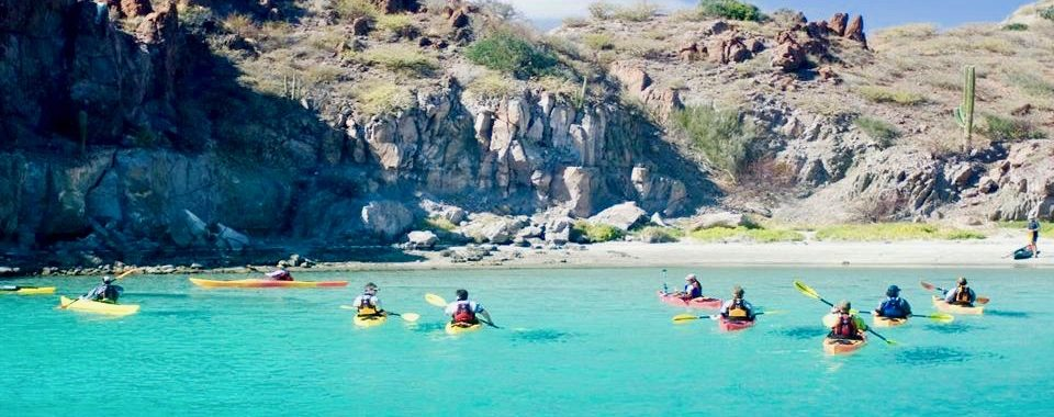 sea kayaks in a cove in Baja