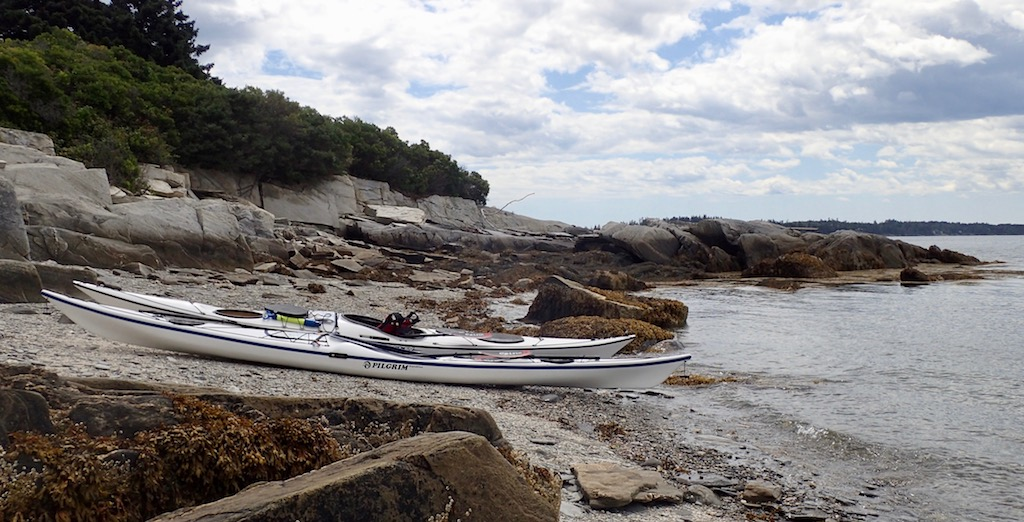 white kayaks on an island beach