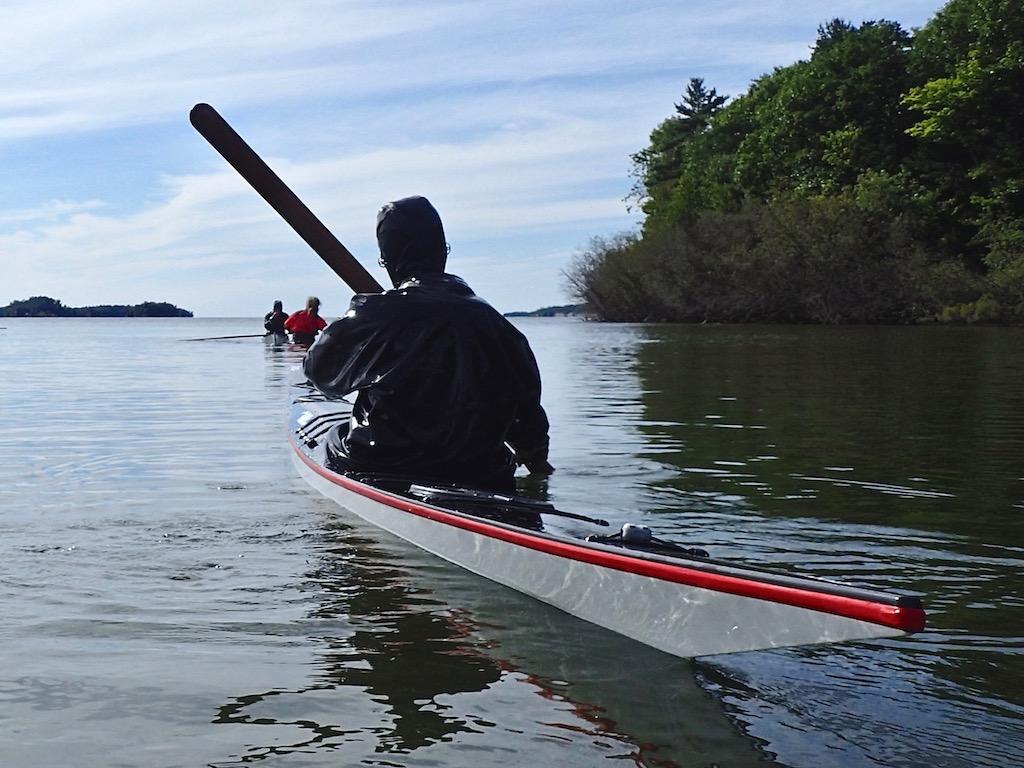 paddling a Greenland-style sea kayak