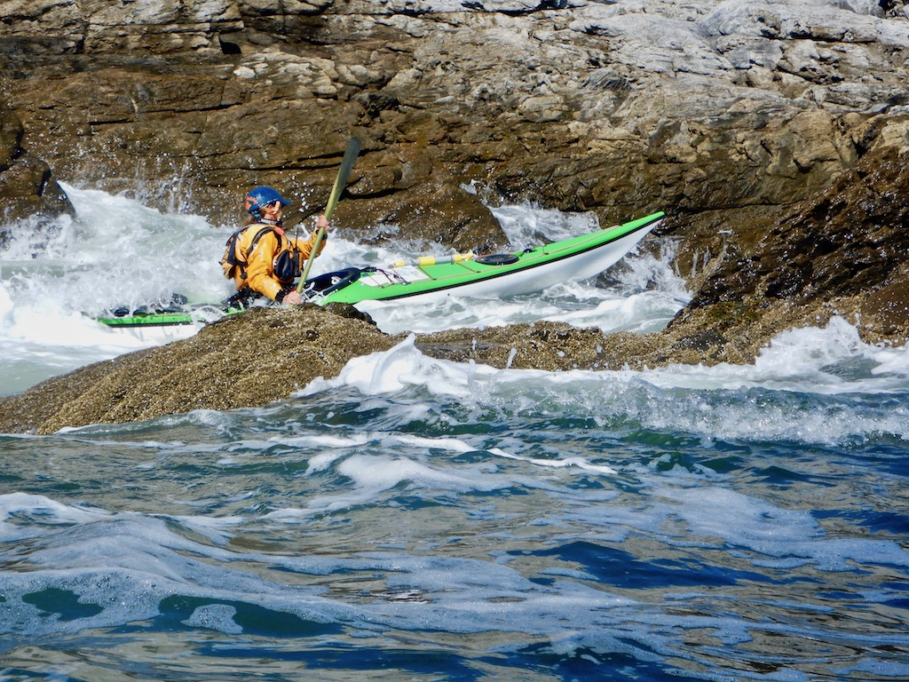 Ginni Callahan drives her kayak through the rocks at the Maine Greenland Kayak Festival