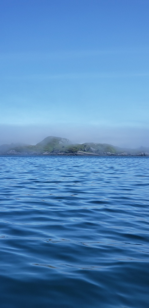 Island emerging from the fog