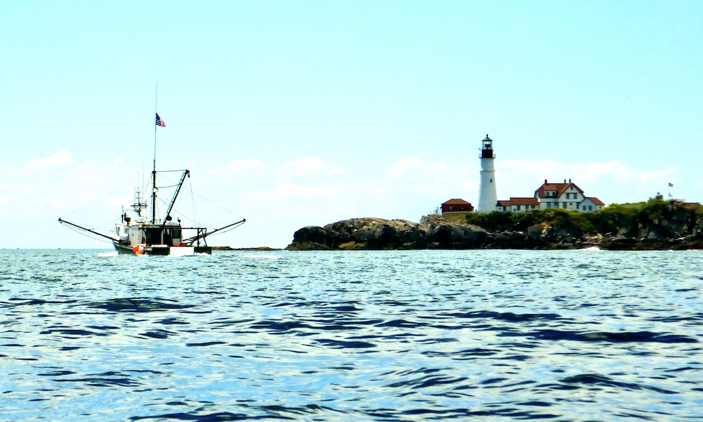 Trawler passes Portland Head Light